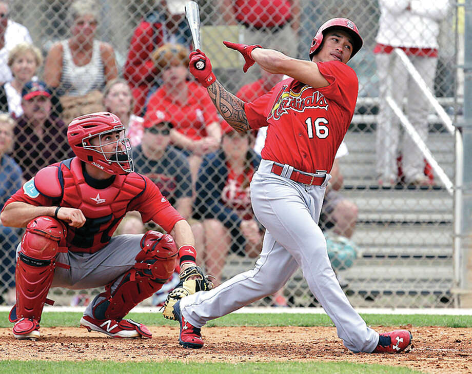 The Cardinals' Kolten Wong swings during spring training intrasquad baseball game earlier Monday in Jupiter, Fla. Photo: AP