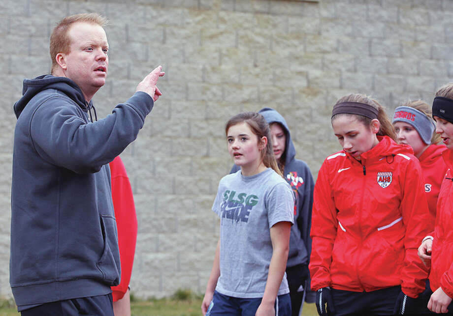 Alton Redbirds varsity girls soccer coach Jeff Hayes instructs players during practice Wednesday at Alton High School. Photo: Billy Hurst | For The Telegraph