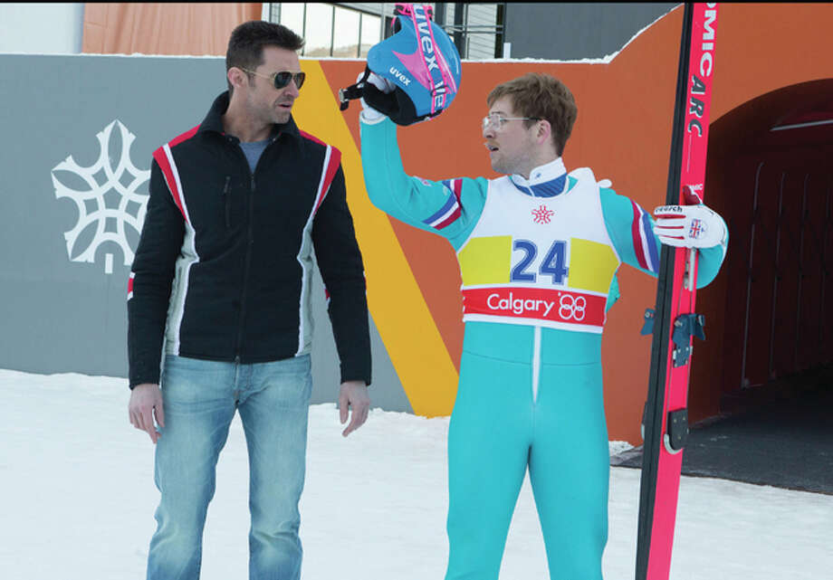 "Taron Egerton, right, and Hugh Jackman star in ""Eddie the Eagle."""