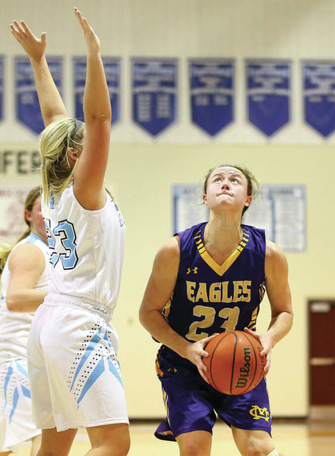 CM junior Allie Troeckler (right) looks to shoot over Jersey's Lauren Davis in an Eagles' tourney win Dec. 28 at Jerseyville. Troeckler became a two-time AP All-Stater on Thursday, earning Class 3A second-team recognition after being named first team as a sophomore. Photo: Billy Hurst / For The Telegraph