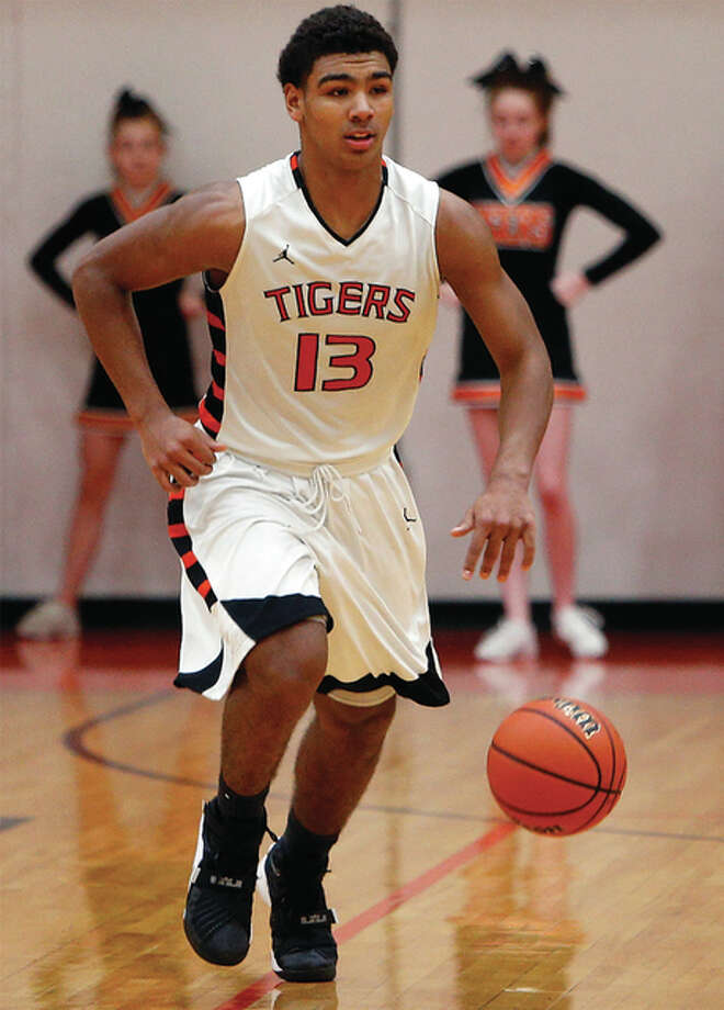 Edwardsville junior Mark Smith finished with 26 points and eight assists Friday night ot lead the Tigers to a win over Belleville East in the championship game of the East St. Louis Class 4A Regional. Photo: Scott Kane | For The Telegraph