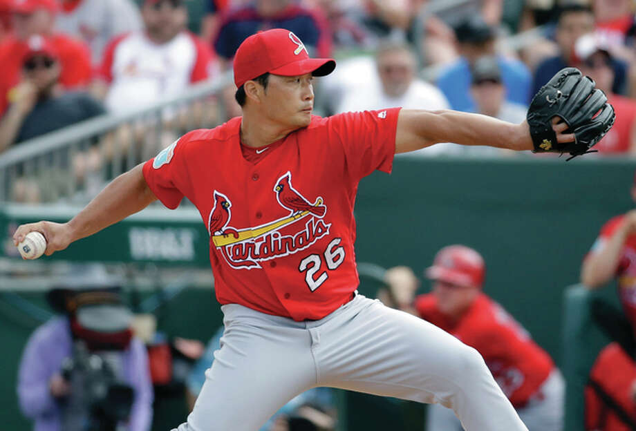 Cardinals relief pitcher Seung Hwan Oh throws during the third inning of an spring training game against the Miami Marlins on Saturday in Jupiter, Fla. Photo: Associated Press