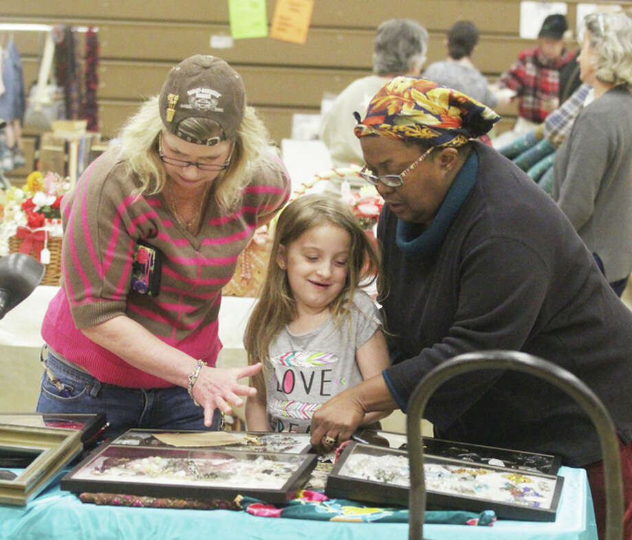 Shari Swafford, left, of Jerseyville and her granddaughter, Kaelee Mae, 8, of St. Louis, look at jewelry offered by vendor Francine Armstead, of Alton, at the third annual Jerseyville Parks and Recreation Department rummage sale, held Saturday. More than 500 people came out to look at wares from 20 different vendors.