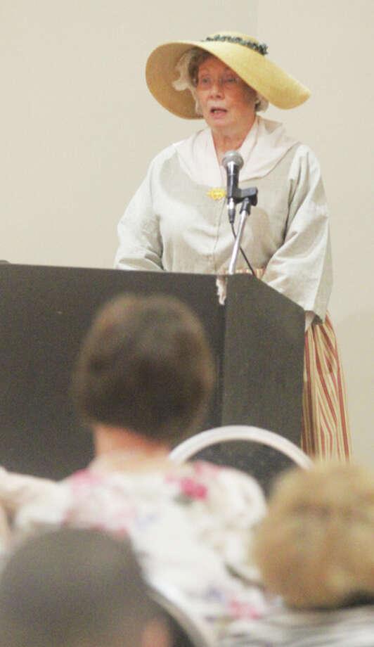 Reenactor Joanne Lenhardt speaks as Ann Gilham, an early settler to the area, at the 33rd Eva A. McDonald Women's History Coalition's annual breakfast, held Saturday at the Atrium Hotel and Conference Center in Alton. Photo: Scott Cousins/For The Telegraph