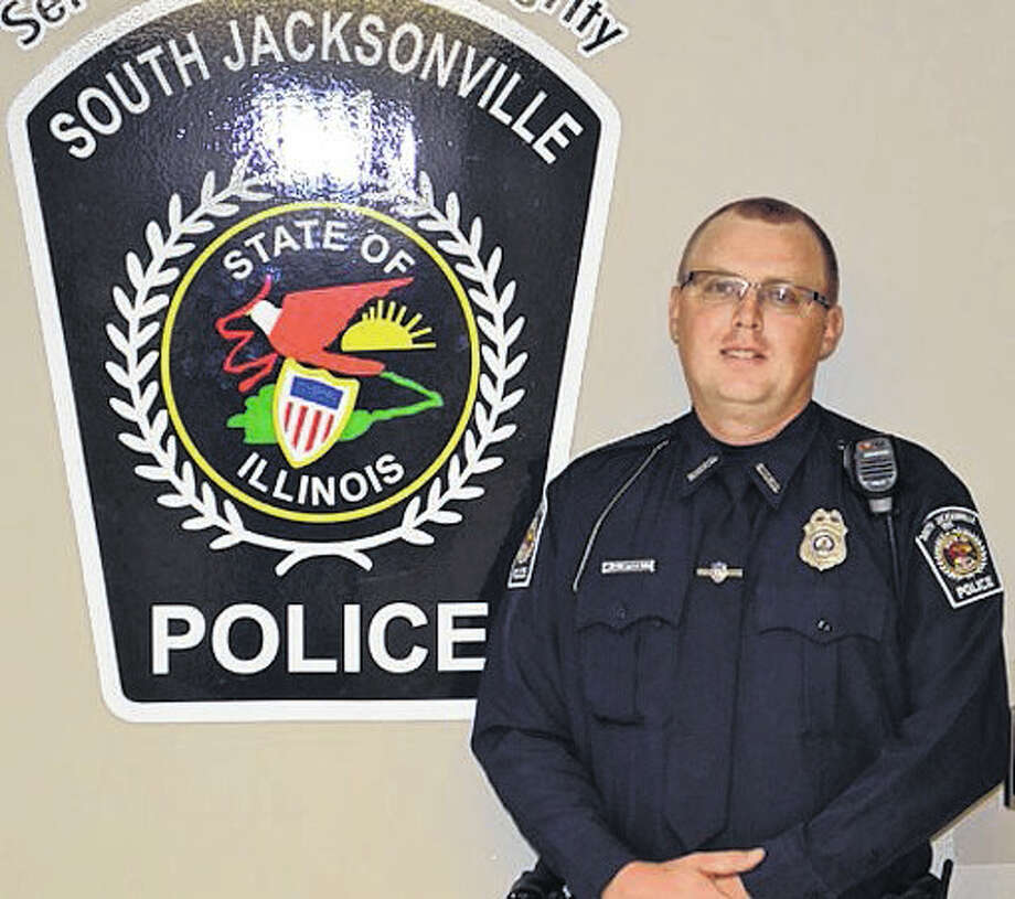 In honor of South Jacksonville Police Officer Scot Fitzgerald, Jacksonville Mayor Andy Ezard has ordered that all flags be lowered to half-staff. Photo: Photo Provided | For The Telegraph