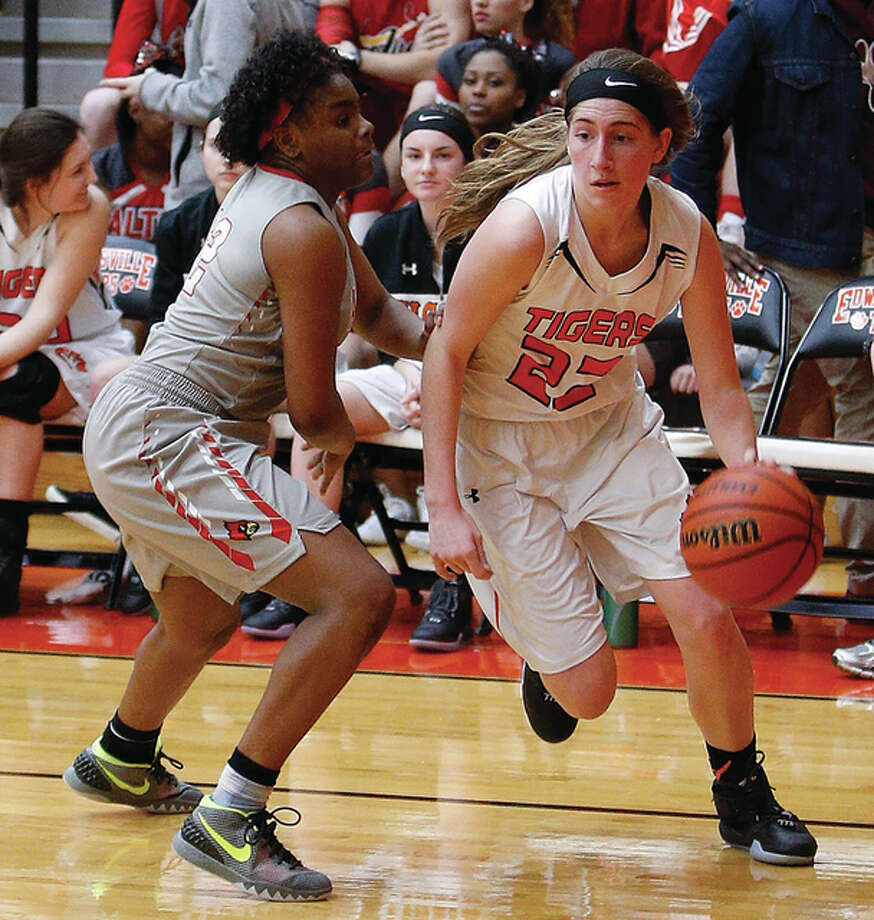 Edwardsville sophomore Kate Martin (right) drives past Alton's Cri'Shonna Hickman during a Tigers victory Jan. 15 at Lucco-Jackson Gym in Edwardsville. Martin is one of four Division I prospects returning next season from a team that finished 30-2 in 2016. Photo: Scott Kane / For The Telegraph
