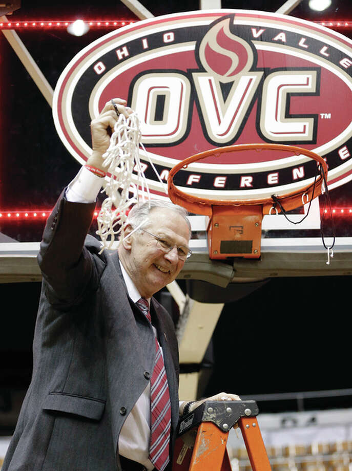 Austin Peay coach Dave Loos cuts down the net after beating UT Martin on Saturday night in the championship game of the Ohio Valley Conference tournament in Nashville, Tenn.