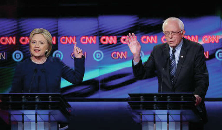 Democratic presidential candidate, Hillary Clinton argues a point as Sen. Bernie Sanders, I-Vermont, reacts during a Democratic presidential primary debate at the University of Michigan-Flint, Sunday, March 6, in Flint, Michigan. Photo: (AP Photo/Carlos Osorio)