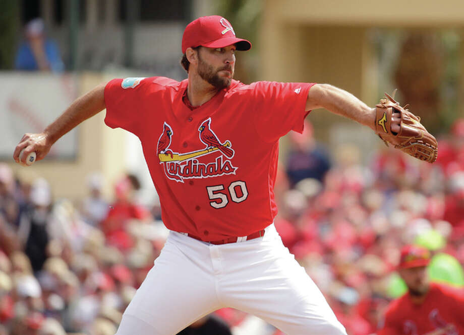 Cardinals pitcher Adam Wainwright throws during the first inning of a spring training game against the New York Mets on Monday in Jupiter, Fla. Photo: Associated Press