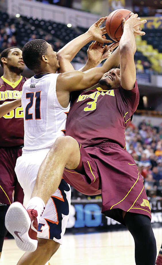 Illinois' Malcolm Hill (21) and Minnesota's Jordan Murphy (3) battle for a rebound in the first half of Wednesday's Big Ten Conference Tournament game in Indianapolis. Photo: Michael Conroy | AP Photo