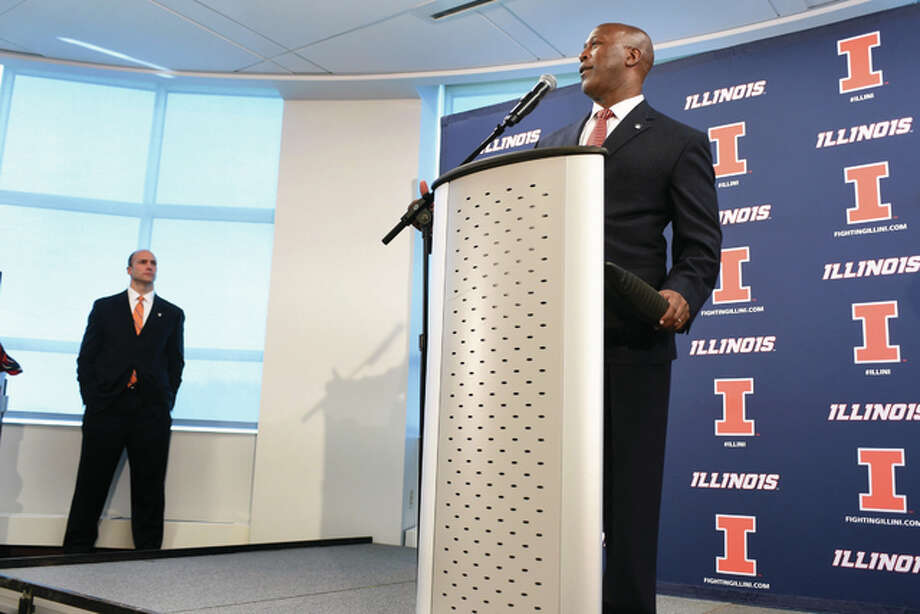New Illini football coach Lovie Smith, right, speaks with reporters last week as new Illinois athletic director Josh Whitman looks on.