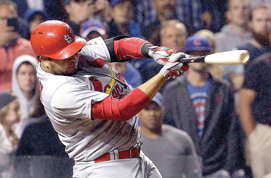 The Cardinals' Jhonny Peralta, shown hitting a two-run home run against the Cubs last season, underwent surgery Thursday for an injury to his left thumb and is expected to miss 10 to 12 weeks. Photo: AP File Photo