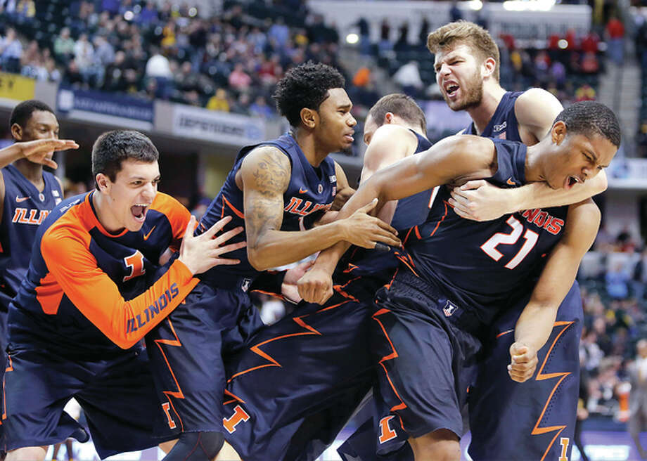 Illinois players celebrate Thursday's 68-66 win over Iowa at the Big Ten Tournament in Indianapolis. Photo: AP
