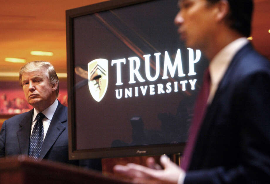 In this May 23, 2005, file photo, real estate mogul and Reality TV star Donald Trump, left, listens as Michael Sexton introduces him at a news conference in New York where he announced the establishment of Trump University. Tarla Makaeff a yoga instructor, has had enough of Trump after six years fighting him in court. Makaeff, wants to withdraw from a federal class-action lawsuit that claims Trump University fleeced students with an empty promise to teach them real estate.