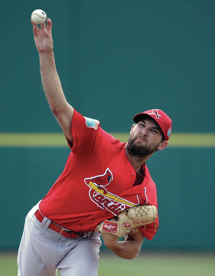 Cardinals starting pitcher Michael Wacha throws in the first inning of a spring training game against the Washington Nationals on Sunday in Viera, Fla. Wacha gave up three runs and six hits in two innings. Photo: Associated Press