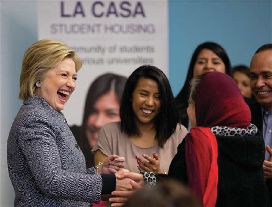 Democratic presidential candidate Hillary Clinton greets people at an immigration round table at The Resurrection Project at La Casa in the Pilsen neighborhood of Chicago, Monday, March 14. At far right is Rep. Luis Gutierrez, D-Illinois. Photo: (AP Photo/Carolyn Kaster)