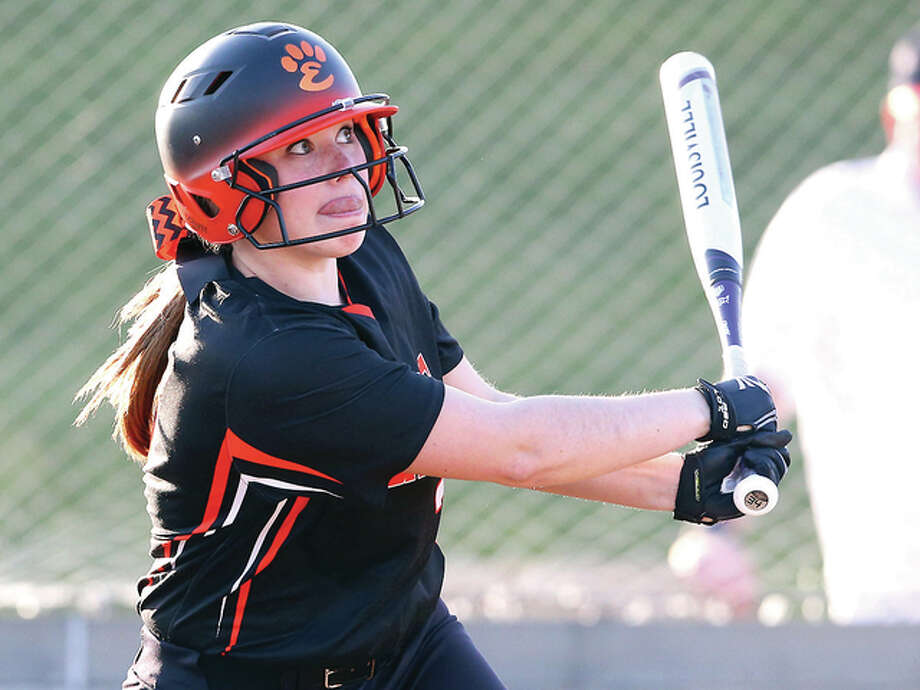 Edwardsville's Allison Loehr watches her home run clear the centerfield fence Tuesday in her team's 12-6 win over Civic Memorial at the Bethalto Sports Complex. Photo: Billy Hurst | For The Telegraph