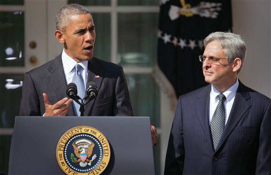 Federal appeals court judge Merrick Garland, right, stands with President Barack Obama as he is introduced as Obama's nominee for the Supreme Court during an announcement in the Rose Garden of the White House, in Washington, Wednesday, March 16, 2016. (AP Photo/Pablo Martinez Monsivais) Photo: (AP Photo/Pablo Martinez Monsivais)