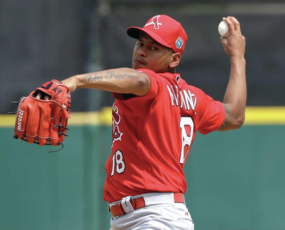 Cardinals pitcher Carlos Martinez throws to the plate in the second inning of a spring training game against the Detroit Tigers on Thursday in Lakeland, Fla. Photo: Associated Press