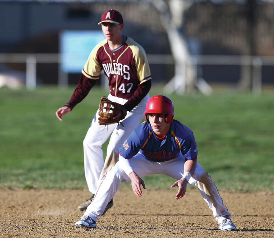 Roxana's Blake Vandiver (front) leads off second base as EA-WR shortstop Tyler Hamby gets his defensive position during a nonconference game between the neighboring rivals Thursday afternoon at Norris Dorsey Field in Wood River. Photo: Billy Hurst / For The Telegraph