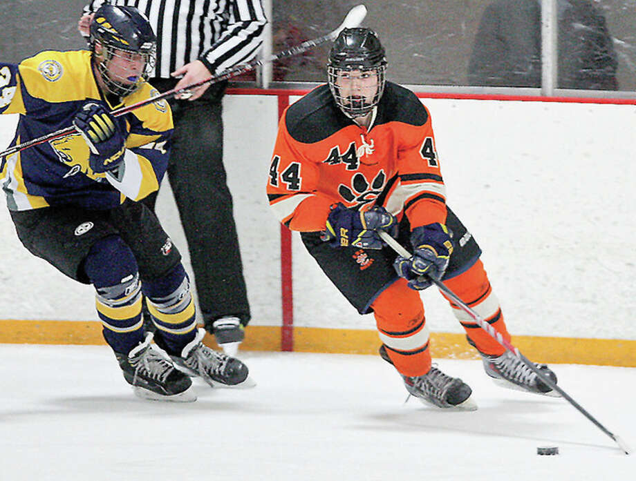 Edwardsville's Tyler Schaeffer (44) scored a pair of goals, including the game winner in overtime in Friday's 3-2 victory over Stone Bridge, Virginia at the USA Hockey Toyota National High School Tournament. Edwardsville is a game away from winning its pool and advancing to the tournament quarterfinals. Photo: Telegraph File Photo