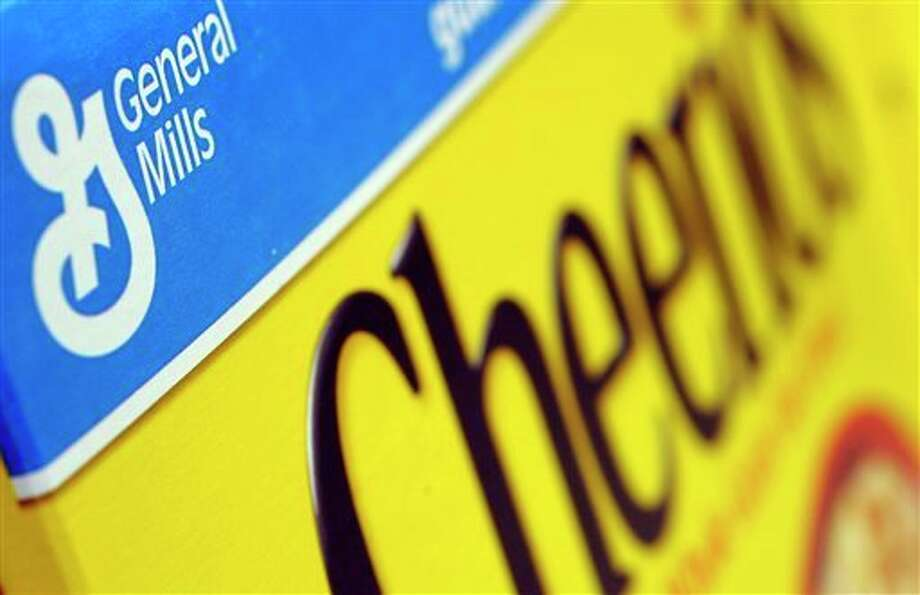 In this Dec. 15, 2007 file photo, a box of General Mills' Cheerios is seen on a shelf at a Shaw's Supermarket in Gloucester, Mass. General Mills says it will start labeling products across the country that contain genetically modified ingredients to comply with a law that is set to go into effect in Vermont. The maker of Cheerios cereal, Progresso soups and Yoplait yogurt notes it is impractical to label its products for just one state, so the disclosures required by Vermont starting in July 2016 will be on its products throughout the U.S.