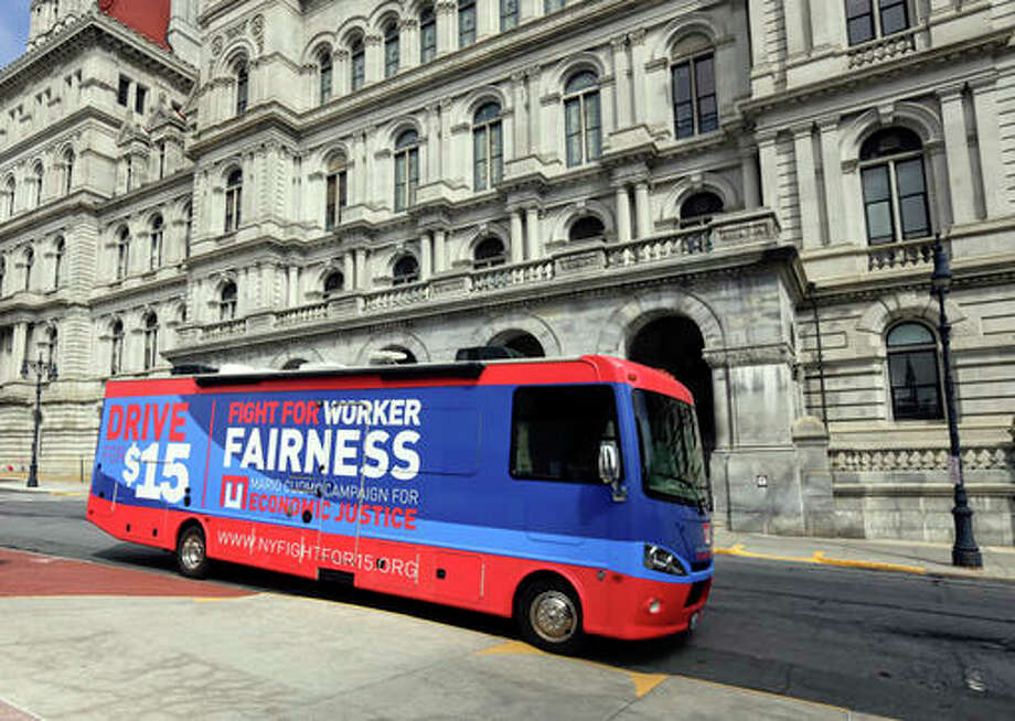 In this Tuesday, March 15, 2016 photo, a recreational vehicle used by New York Gov. Andrew Cuomo in his efforts to raise the minimum wage is parked near the state Capitol in Albany, N.Y. Supporters of Cuomo's plan to raise New York's minimum wage to $15 say they won't accept any legislative compromise that settles on a lower figure.