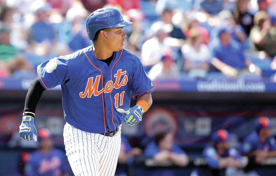 Former mets shortstop Ruben Tejada watches his two-run home run in a spring training game against the Cardinals on March 10. Saturday, the Cardinals signed Tejada to a one-year contract for $1.5 milllion. Photo: AP