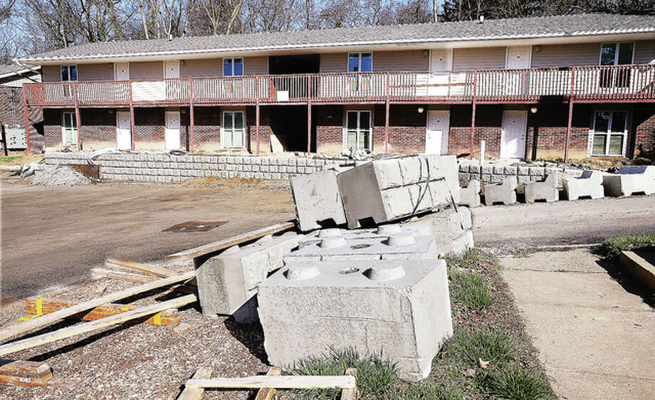 Retaining wall blocks lay scattered about the renovation site for the apartments at The Landing at Belle Meadows in Alton. The project is on hold pending a solution to an interruption in funding.