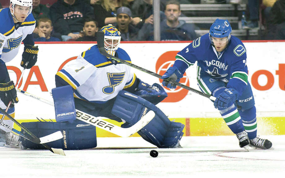 Vancouver Canucks' Linden Vey (7) skates for the puck near Blues' goalie Brian Elliott Saturday night in Vancouver, British Columbia. Photo: Ben Nelms, The Canadian Press Via AP