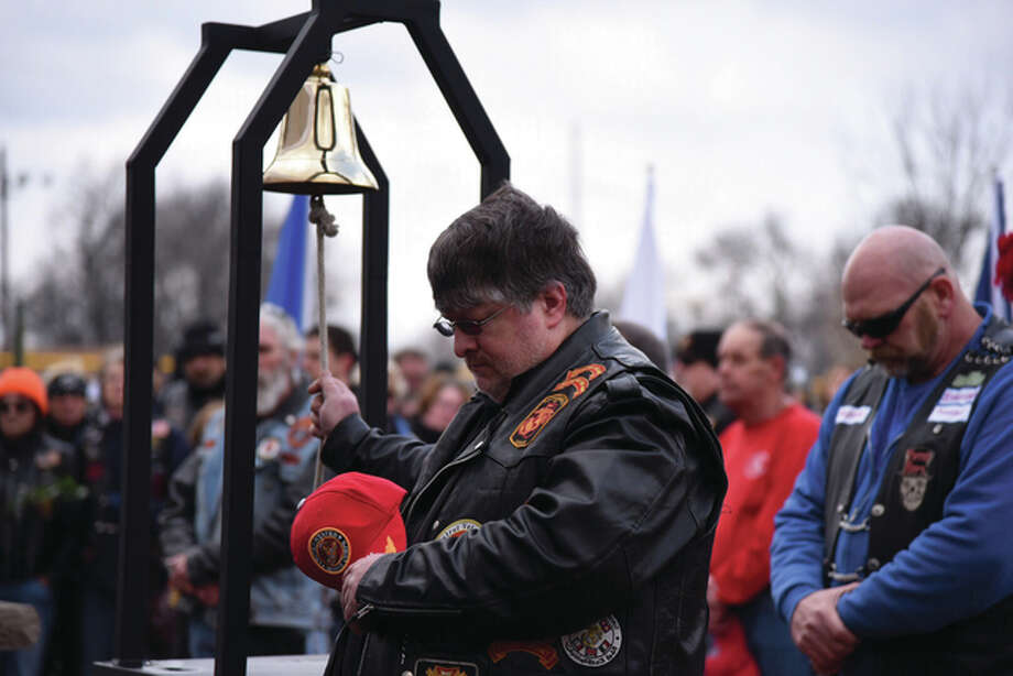 A ceremonial bell is rung after the name of each biker is read at the annual Blessing of the Bikes memorial service held each year at the Rox-Arena in Roxana. Photo: Kevin Korinek | For The Telegraph