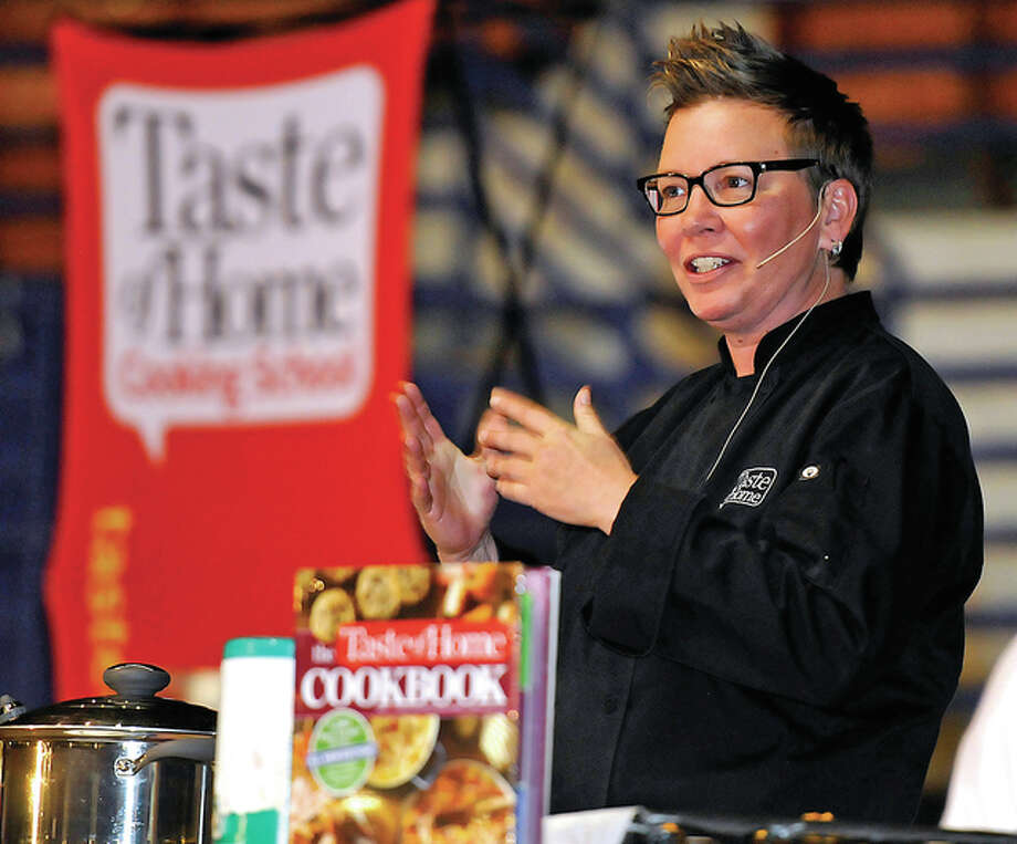 Culinary specialist Dana Elliott introduces herself to the large crowd in attendance at the Taste of Home Cooking Show at the Beckley-Raleigh County Convention Center.