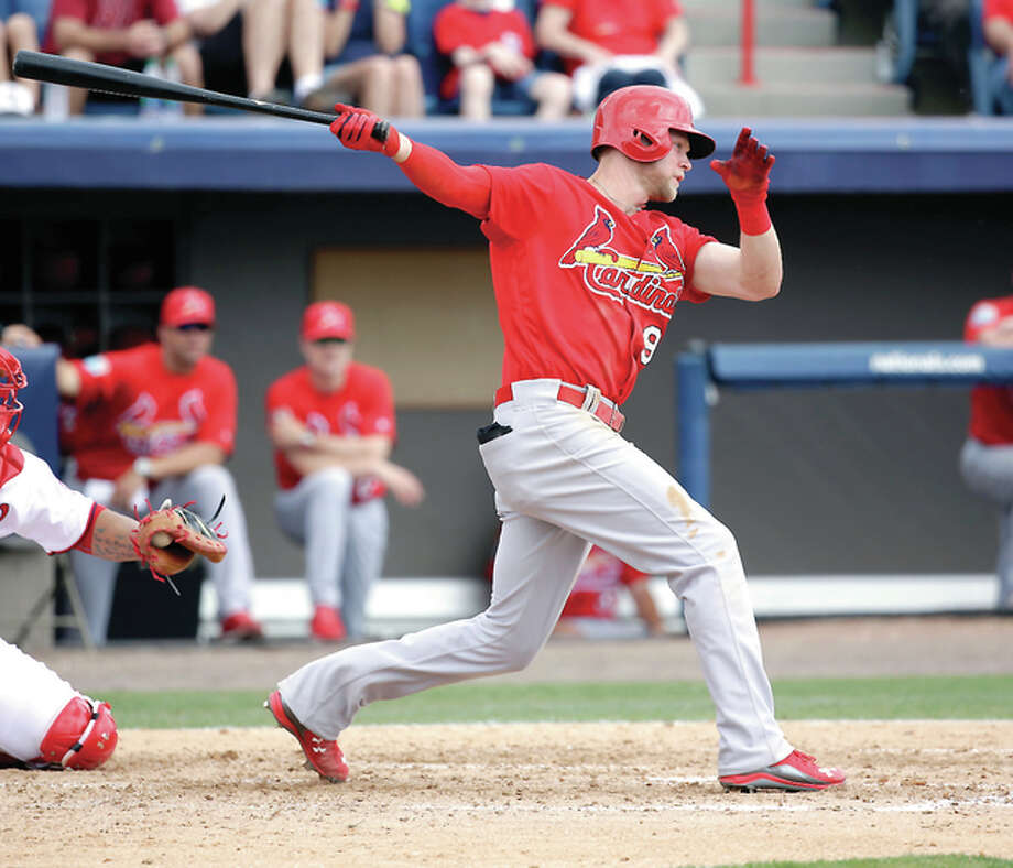 The Cardinals' Jeremy Hazelbaker blasted a towering two-run home run over the right field wall of Roger Dean Stadium off Red Sox reliever Jamie Callahan in Monday's 4-3 St. Louis loss. He is shown batting earlier in spring training. Photo: AP