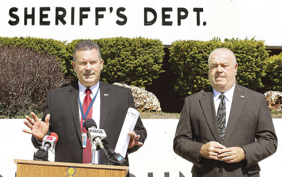"Madison County Sheriff's Department Maj. Jeff Connor, left, and Sheriff John Lakin address the press Tuesday outside the sheriff's office in Edwardsville regarding a cold case homicide from June 2004. Police have identified the headless, handless and legless torso of a woman left along Interstate 70 in Warren County, Missouri, as Deanna D. Howland of Alton. The Major Case Squad of Greater St. Louis has been activated and police are seeking ""any information"" about the victim, who would have been 35 years old at the time of her death 12 years ago."