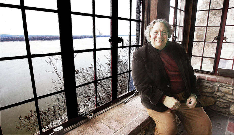 Architect John C. Guenther relaxes by the scenic view from one of the historic structures on the property of the Missionary Oblates of Mary Immaculate, formerly the property of Charles Levis (1860-1948), the son of Edward W. Levis (1820-1902), who along with William Eliot Smith, purchased the Illinois Glass Works in 1873. The great room of the small accessory building at the religious novitiate, has a fireplace, small loft and a fantastic view of the river from the top of the bluffs. Photo: John Badman | The Telegraph