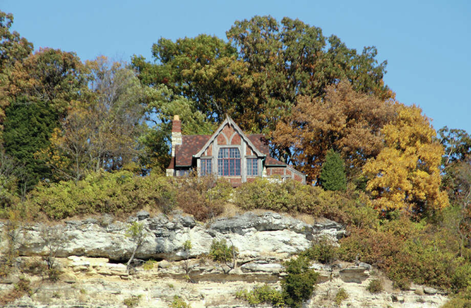 As a longtime sailor who moors his vessel at the Alton Marina and navigates the Mississippi River, every time John C. Guenther and his wife sailed by the Missionary Oblates of Mary Immaculate's bluff-top property, the couple mused about the origin and purpose of the curious little lodge, pictured, designed for Charles Levis by architect Preston J. Bradshaw. Photo: John C. Guenther | For The Telegraph