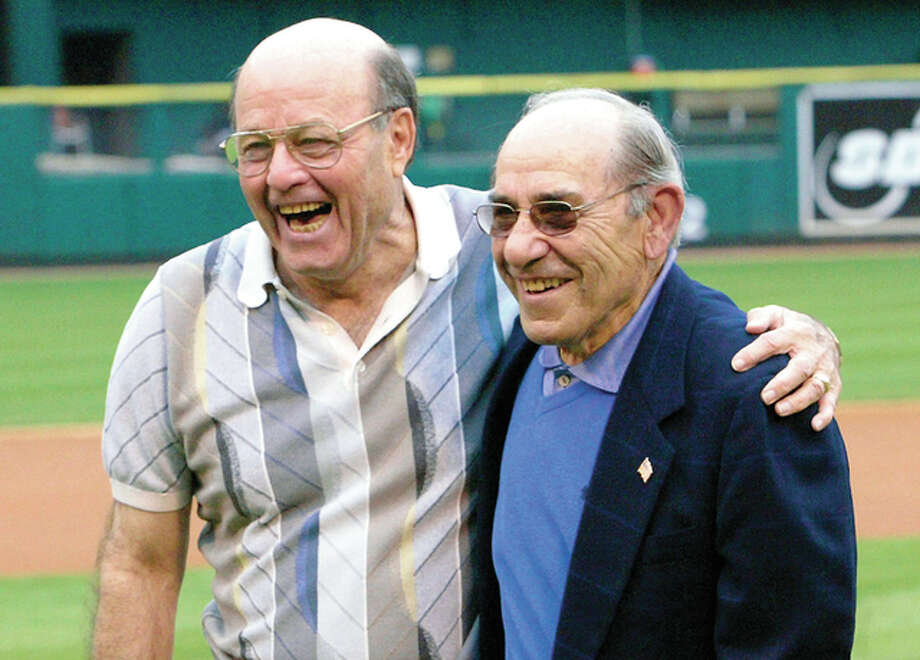 In this 2003 file photo, baseball Hall of Famers Joe Garagiola, left, and Yogi Berra share a moment after throwing out the first pitch before a game between the Pittsburgh Pirates and St. Louis Cardinals, at Busch Stadium II in St. Louis. A former big league catcher and popular broadcaster, Garagiola died Wednesday. He was 90. Photo: AP