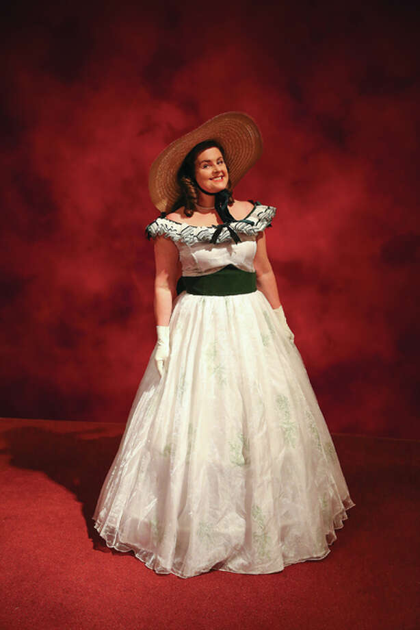 "Kayla Mack models a ""Gone With The Wind"" barbecue dress that was featured in Alton Little Theater's production of ""Moonlight and Magnolias."" Photo: Pete Basola 