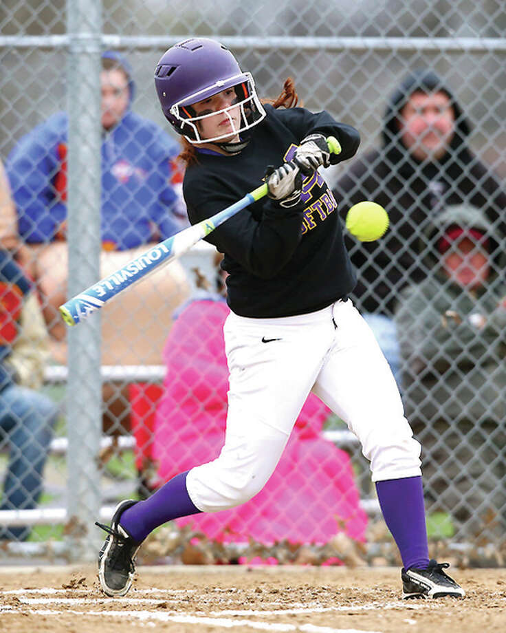 Civic Memorial's Cassie Reed connects for a hit, driving in Katelyn Turbyfill Thursday in Roxana. Photo: Billy Hurst | For The Telegraph