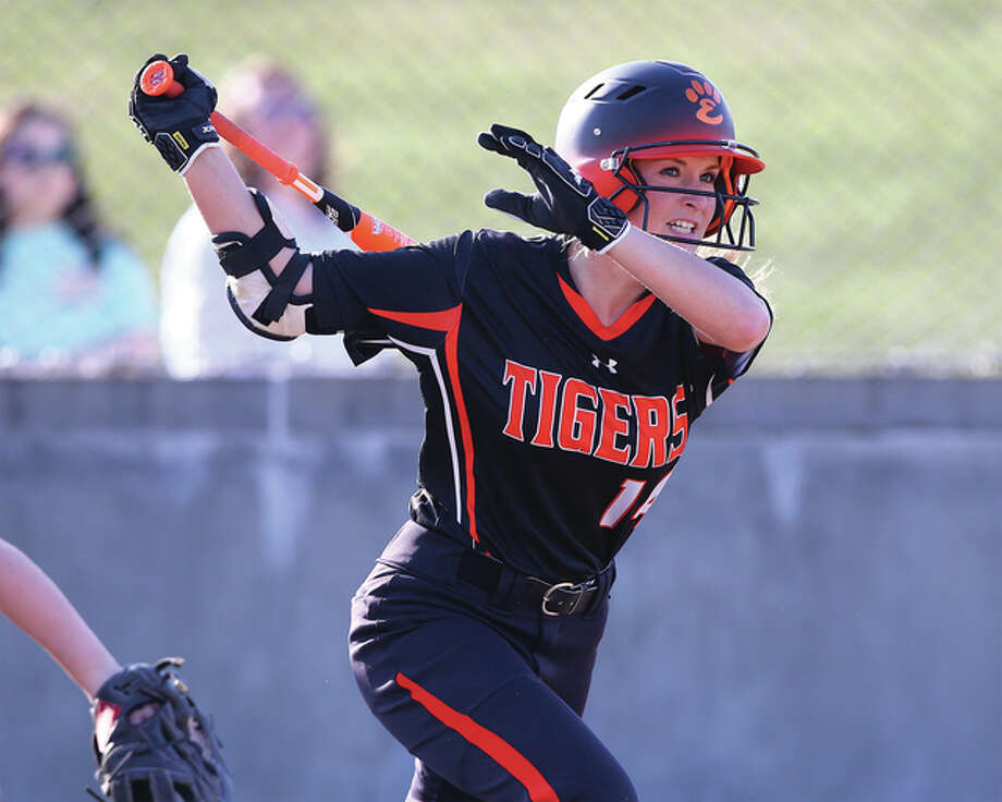Edwardsville's Rachel Anderson watches a ball hit to the gap in right-center field during the Tigers' season-opening victory over Civic Memorial at the Bethalto Sports Complex. Anderson, who will play Division I college softball at Southeast Missouri, returns for her fourth season as a starter. Photo: Billy Hurst / For The Telegraph