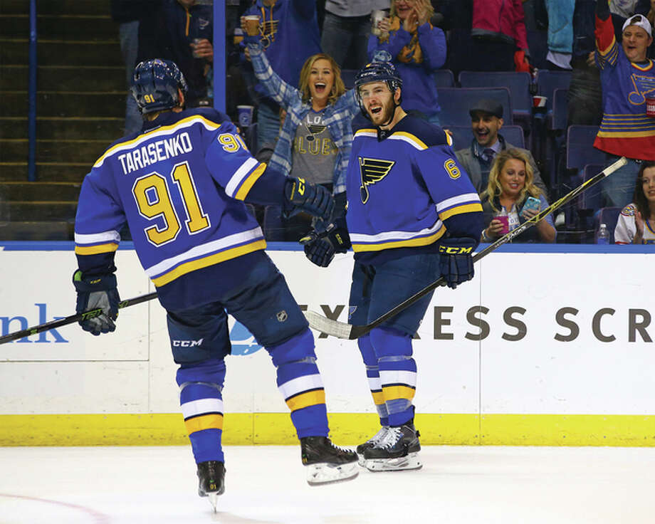 Blues defenseman Joel Edmundson (right) celebrates with Vladimir Tarasenko (91) after Edmundson's his first NHL goal during the third period Friday night against the Vancouver Canucks in St. Louis. The Blues won the game 4-0. Photo: Billy Hurst / For The Telegraph