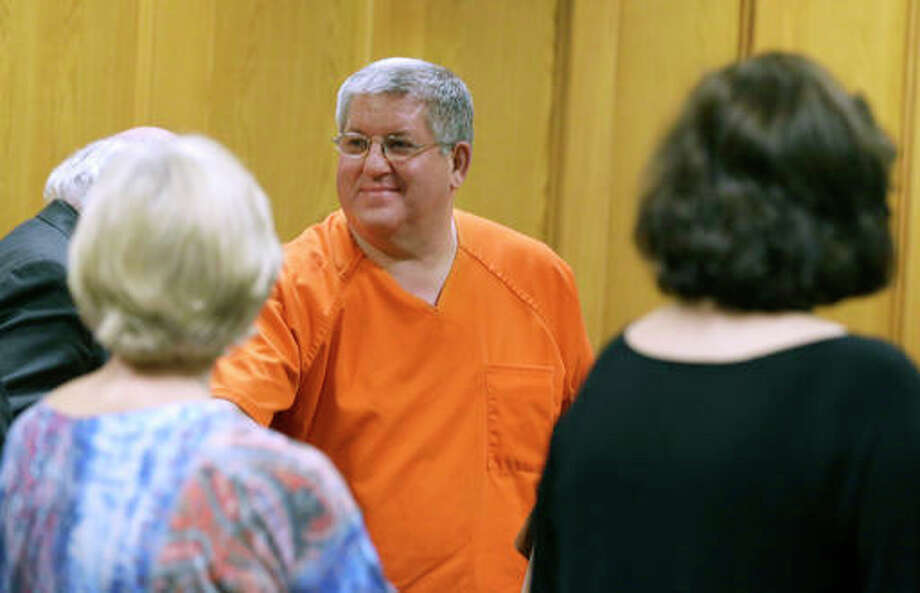 "Bernie Tiede smiles after a court hearing granting his release at the Panola County court house in Carthage, Texas. Tiede had been sentenced to life for killing 81-year-old widow Marjorie Nugent for her fortune. Tiede now faces a new sentencing in the case that inspired the dark comedy ""Bernie."""