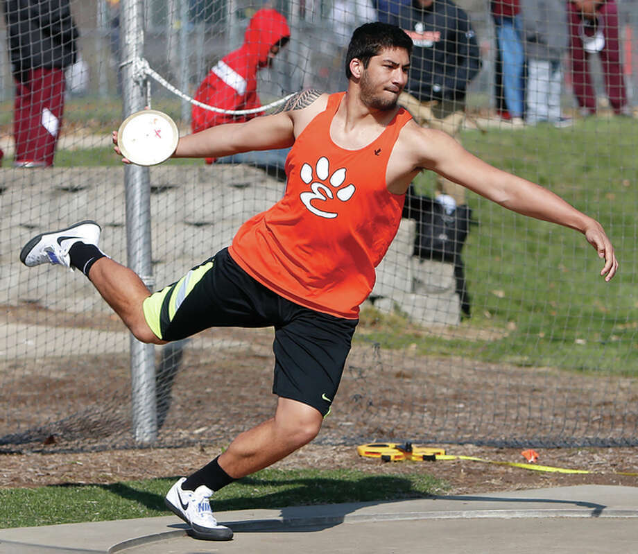 Edwardsville junior AJ Epenesa competes in discus Saturday at the Southwestern Illinois Relays at the Winston Brown Track Complex in Edwardsville. Epenesa won the event with a meet-record throw of 185 feet, 3 inches. He also won the shot put. Photo: Scott Kane / For The Telegraph