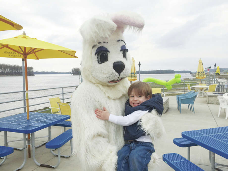 Landon Wilson gets a hug from the Easter bunny Sunday during the Easter Eggstravaganza celebration at The Loading Dock. Photo: Kevin Korinek | For The Telegraph