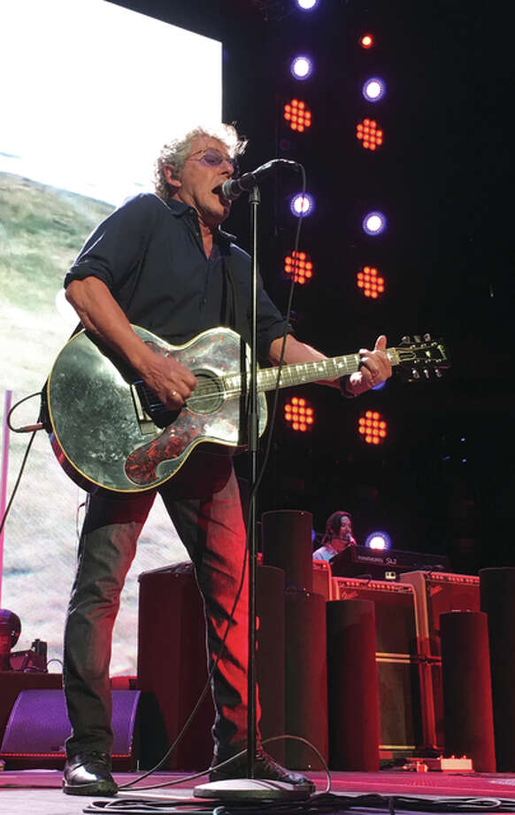 "The Who opened its St. Louis show with ""Who Are You"" followed by ""The Seeker"" and ""The Kids are Alright"" Saturday night for The Who Hits 50! North American Tour's rescheduled date at Scottrade Center. Lead singer Roger Daltrey, pictured, previously had vocal cord issues that caused postponement of two previous St. Louis dates. There were no signs of trouble Saturday night as Daltrey gave an outstanding performance and still hit the thrilling high notes on ""Love Reign O'er Me"" and ""Won't Get Fooled Again."" Jill Moon 