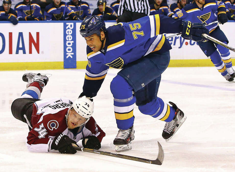 Colorado's Carl Soderberg (left) hits the ice after colliding with the Blues' Ryan Reaves during the second period Tuesday night in St. Louis.