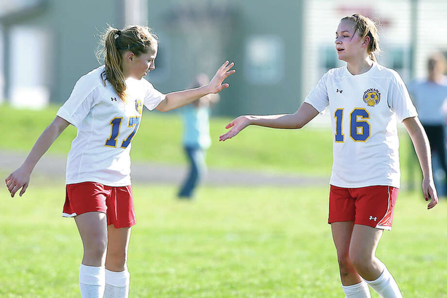 Roxana's Emma Lucas, right, scored a goal and teammate Haley Milazzo had an assist in Tuesday's 3-0 win over East Alton -Wood River in the second round of the Oilers Soccer Tournament at the Wood River Soccer Park. The two are shown celebrating a goal earlier this season. Photo: Billy Hurst | For The Telegraph