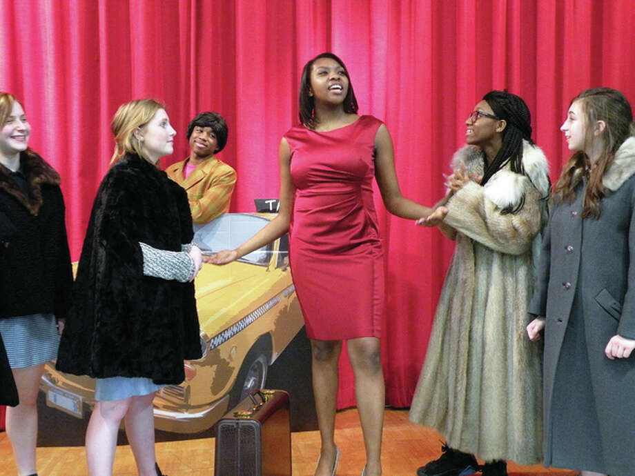 """On the streets of New York City, a new """"Star To Be (Amarria Mumphard, center),"""" belts out a song while people on the street stop to listen, from left, Brooke (Brooke Lucas), Annie (Margaret Sommerhof), taxi driver (Kelcey Johnson), Trinity (Trinity Brooks) and Abby (Abby Fahnestock). Photo: For The Telegraph"""