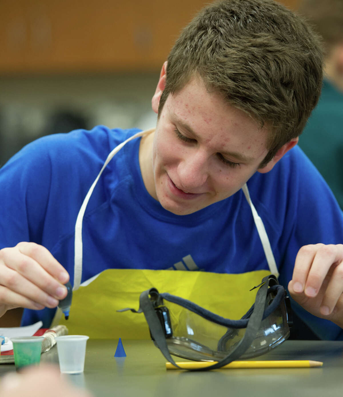 Ian Wall, of Belleville, participates in a science lab provided to his homeschool network by the SIUE STEM Center.