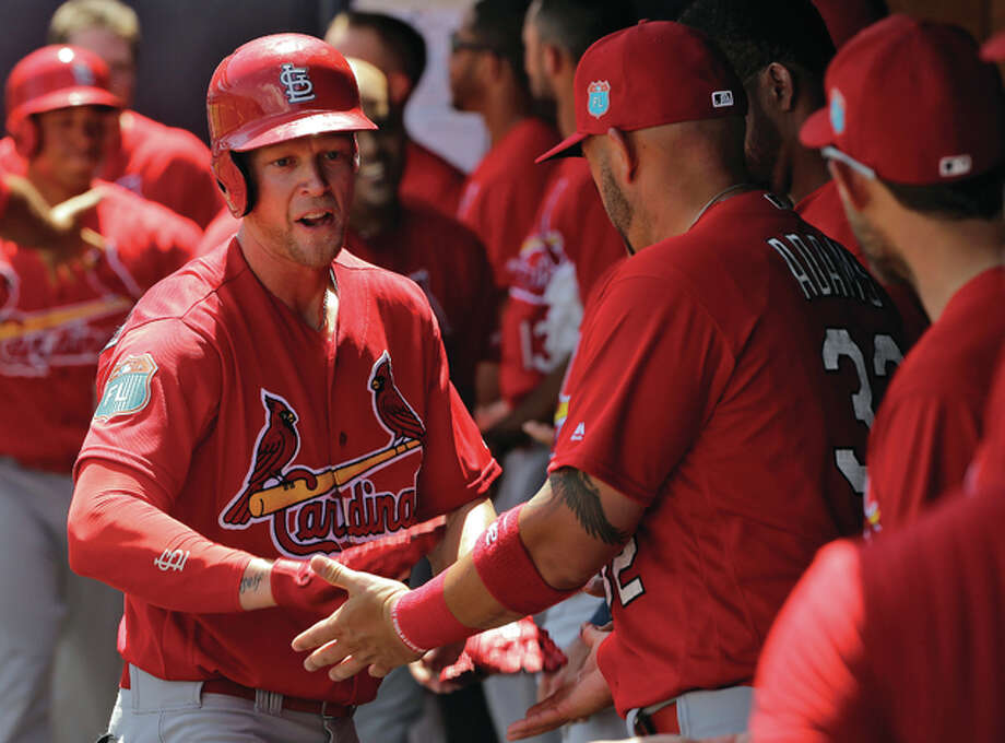 The Cardinals' Jeremy Hazelbaker celebrates with teammates in the dugout after his home run against the New York Yankees during a spring training game Thursday in Tampa, Fla. Photo: Associated Press